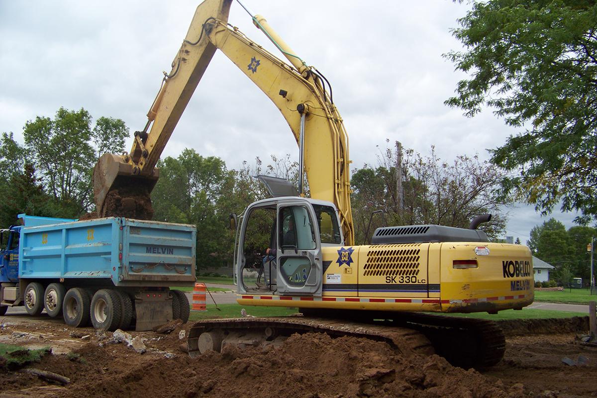Excavator & Dump Truck | Melvin Companies | https://melvincompanies.com